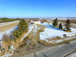 8.2 +/- Acres Commercial Use with 4200 building
